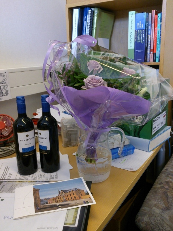 Wine and flowers and a card!